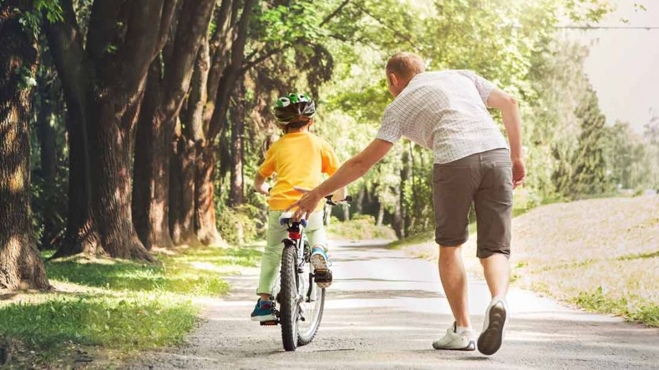 teach_child_ride_bike.jpg